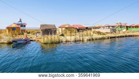 Titicaca Lake Peru, August 16. Thatched Houses On The Floating Islands Of Lake Titicaca. Shoot On Au