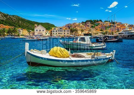 Popular Mediterranean Resort With Harbor And Old Town. Luxury Yachts And Fishing Boats Moored In Hva