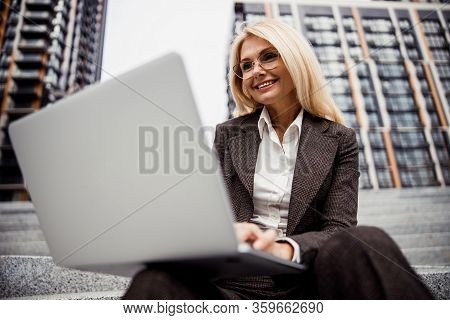 Pleased Lady Gazing At A Computer Screen