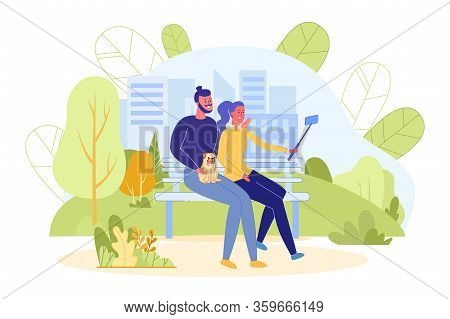 Couple With Pet Dog Makes Selfie Using Mobile Device While Walking In Park. Mobile Phone Photographi