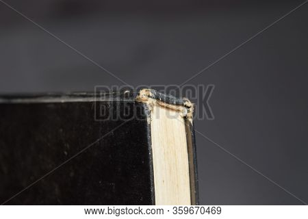 The Binding Of An Old Book In Black Cover.