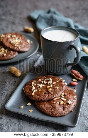 Brownie Cookies Topped With Melted Chocolate And Chopped Peanuts