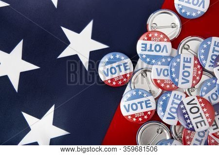 Political Voting Pins For 2020 Elections In Usa In November On American Flag Background, Copy Space