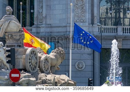 Madrid, Spain - May 11, 2019: The Flags Of Spain And The European Union Fly In Front Of The Bank Of