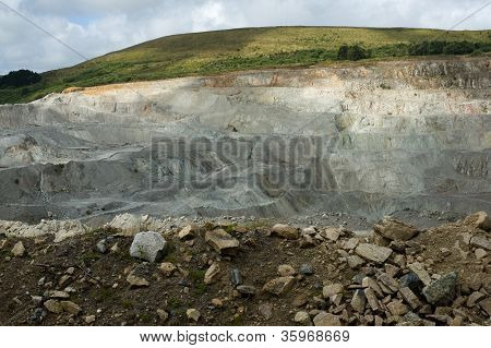 china clay (kaolin) open cast mine showing terraced layers bein worked by excavator poster