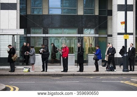 London, Uk - 15 January 2020 Queue At The Bus Stop. People Are Waiting For The Bus And Keep Their Di