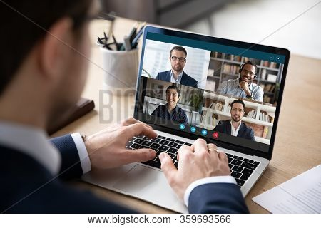 Multiracial Colleagues Engaged At Group Meeting Online Laptop Screen View