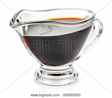 Soy Sauce In A Transparent Glass Gravy Boat Isolated On White Background
