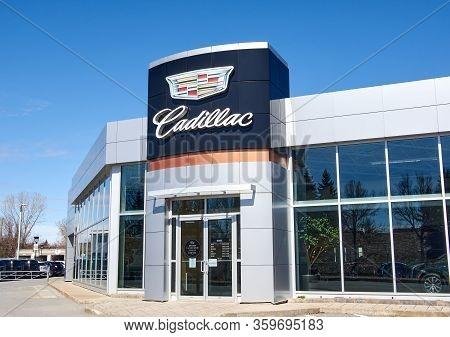 Montreal, Canada - April 4, 2020: Cadillac Dealership Logo And Writing. Cadillac Is A Division Of Am