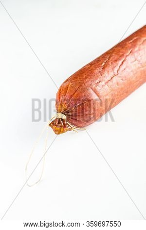 Whole Salami Sausage And Sliced Sausage, Lie On A White Isolated Background