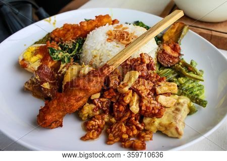 Indonesian, Balinese Traditional Food, Spicy Pork Satay With Fried Soybean, Tempeh,white Rice, And V