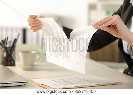 Close Up Of Business Woman Hands Breaking Contract Document Sitting On A Desk At The Office