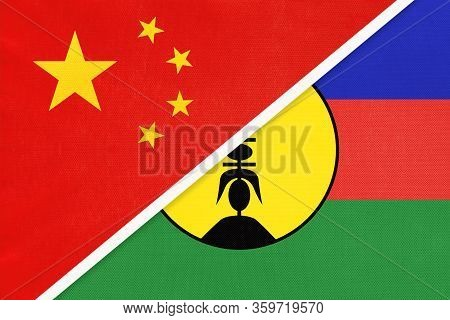 China Or Prc Vs New Caledonia National Flag From Textile. Relationship Between Asian And Oceania Cou