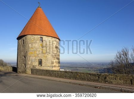 Historic Tower And The Hohenloher Ebene Seen From Waldenburg, A Hilltop Town In Southern Germany At