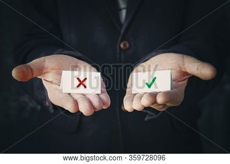 Business Man Select Choice. The Concept Of Choosing The Right Or Wrong Option.