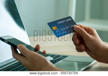 Young Woman Use Credit Card For Shopping Payment Online On Laptop Computer Application Or Website. E