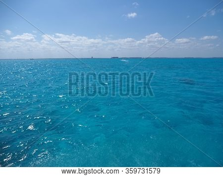 Beautiful Water Between Isla Mujeres And Cancun City At Quintana Roo State In Mexico, Clear Blue Sky
