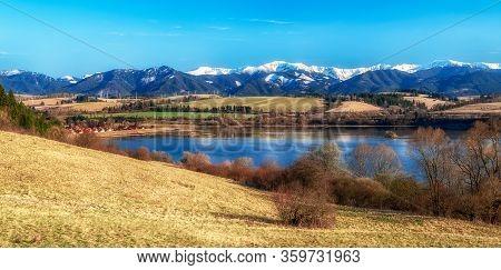Lake Liptovska Mara And Snowy Peaks Of Low Tatras Mountains In Slovakia. Beautiful Panoramic Coutrys