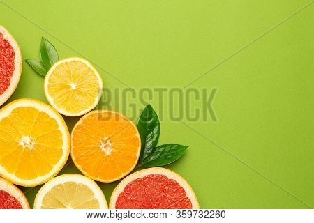 Citruses Fruits On Green Background With Copyspace, Fruit Flatlay, Summer Minimal Compositon With Gr