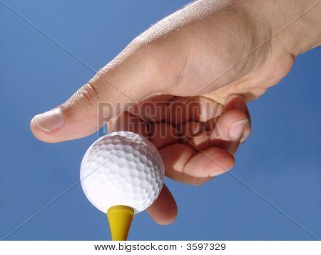 Placing Golf Ball On Tee
