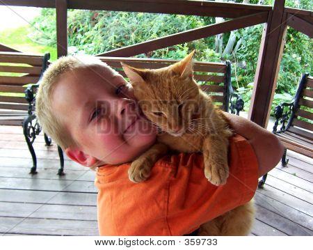 poster of boy hugging cat.