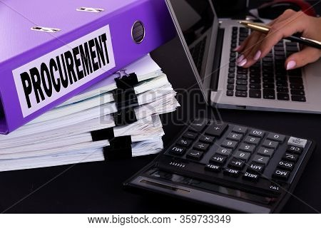 Text, Word Procurement Is Written On A Folder Lying On Documents On An Office Desk With A Laptop And