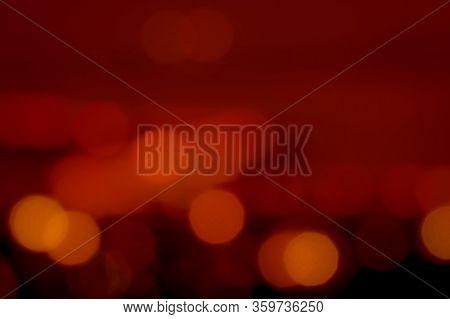 ฺblurred Red And Orange Bokeh Background. Blur Abstract Background Of Urban Light. Warm Light With B