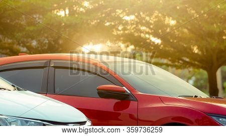 Closeup Red Suv Car Parked At Outdoor Car Parking Area Of Shopping Mall Or Office. Luxury Car Parked
