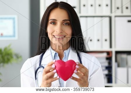 Beautiful Smiling Gp Holding In Hands Red Toy Heart Near Chest Portrait