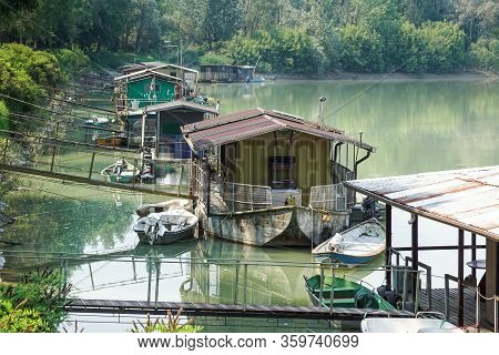 Houseboat Parked By The River Near The Swamp