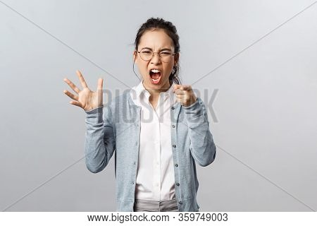 Emotions, Family Therapy And Lifestyle Concept. Its Your Fault. Angry Asian Woman Blame Her Husband