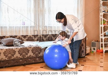 Gym Ball And Baby. Gymnastics Baby. Woman Doing Exercises With A Child For His Development. Exercise