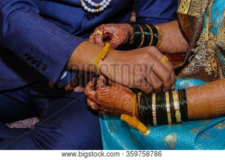 The Hands Of Bride And Groom During Indian Wedding Rituals