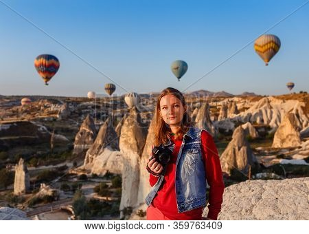 Cappadocia, Turkey - August 23, 2019: Young Beautiful Girl Photographer With Camera In Her Hands And