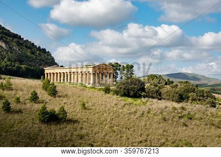 Landscape With Ancient Doric Temple Of Segesta, Sicily, Italy In Nice Sunny Spring Day With Cloud Sh