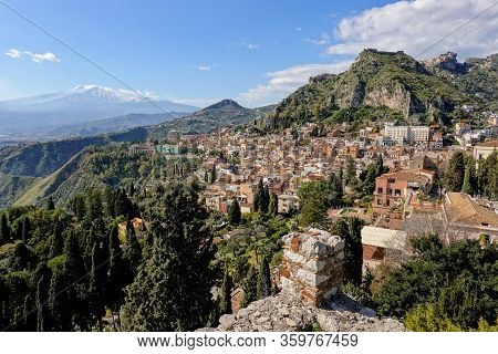 Cityscape Of The Taormina City In Sicily, Italy And Mountains With Etna Volcano In The Background