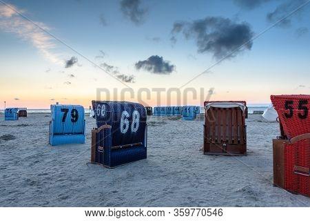 Sand Beach With Beach Chairs In Neuharlingersiel At Dusk, German North Sea Coast, East Frisia, Lower