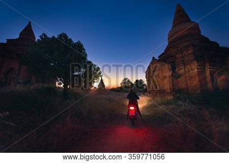 Tourist Visiting Myanmar - Young Woman Exploring City Of Bagan On Electric Scooter
