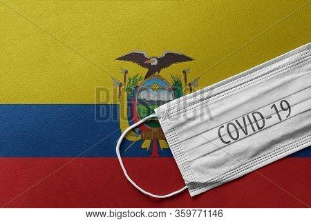 An Individual Face Medical Surgical Mask On Ecuador National Flag Background. Health Mask. Protectio