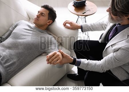 Psychotherapist And Patient In Office. Hypnotherapy Session
