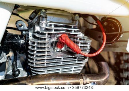 Enduro Cylinder And Motorcycle Spark Plug Close Up.