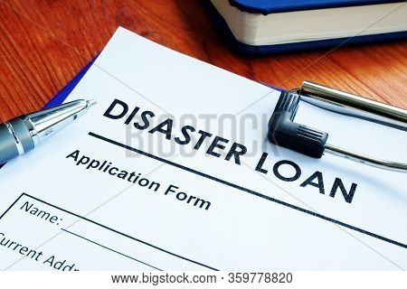 Sba Disaster Loan Application Form On The Wooden Surface.