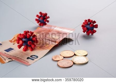 Euro Money, Coins And Models Of Covid-19 Virus On Blue Background Contaminated Infected Cash Money.