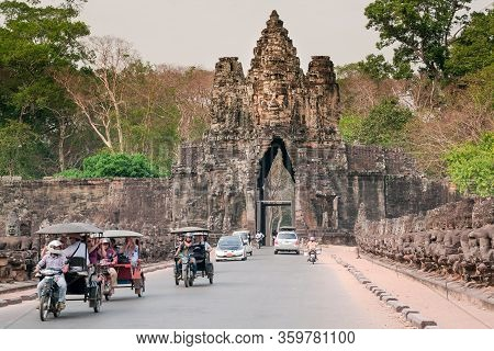Siem Reap, Cambodia: Taxi And Rickshaws Driving From The Gate Of Angkor Thom, Great City Of 12th Cen