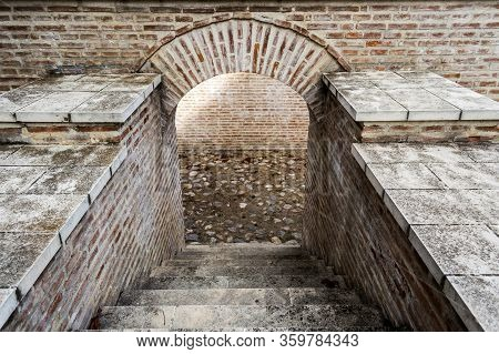 Underground Building With Stairs And An Archway, Basement, Cellar.