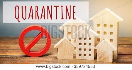 Wooden Houses And The Inscription Quarantine. Coronavirus Pandemic Infection Covid-19. Isolation Of