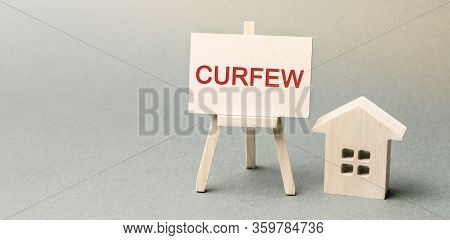 A Poster With The Word Curfew And A House. Prohibition Of Being On The Streets And In Public Places