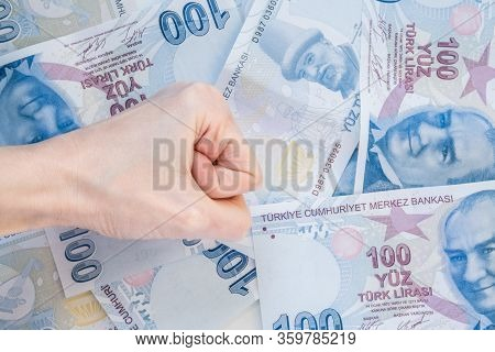 Close Up Of Female Hand On 100 Turkish Lira (try) Banknotes
