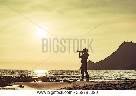 Tourist Woman With Camera Taking Travel Photo On Monsul Beach At Sunset. Cabo De Gata Nijar Natural