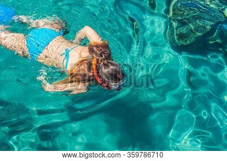 Sea Swimming Clean Aquamarine Water Activity Summer Vacation Concept By Woman Back To Camera Looking